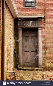 an old door in a brick greenhouse in machusetts
