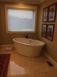 three photos above show master bathorrm remodel which included adding a freestanding tub heated marble tile floor tiled shower with a tiled shower pan