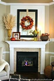 fall mantel decorating layer wreath over mirror above fireplace mantle decor