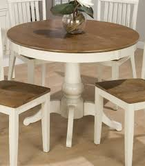 nice traditional dining room with expandable round dining table and small dining chairs
