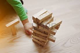 Game Played With Wooden Blocks Hand Of Baby Who Played Developmental Game Of Wooden Blocks Lumber 93