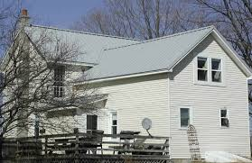 Snow Metal Roofs in Michigan | Snow Country Roofs