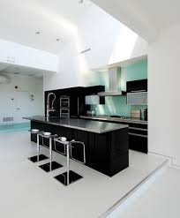 black and white kitchen ideas. Elegant Black And White Themed Kitchen With Center Rectangle Island Complete The Bar Stool Also Stainless Steel Materials Countertop Ideas E