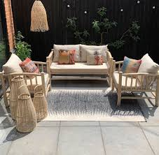 rustic wooden framed garden sofa and