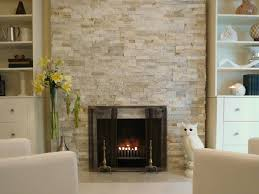 creamy brown and white marble stone surround ventless gas fireplace with modern touch and some ornaments like owl sculpture and some flowers white painted