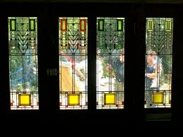 four frank lloyd wright tree of life leaded stained glass panels installed