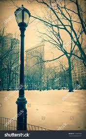 vintage texture style image of lamp post with historic landmark flatiron building new york city