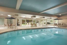 Indoor pool and hot tub Hotel Indoor Pool And Hot Tub With Poolside Tables And Seating Country Inn And Suites Hotels Near Atlanta Airport Country Inn Suites Atlanta Ga
