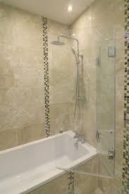besoke bi fold bath screen with frameless glass panels