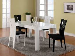 rectangle white lacquer modern dining table with four black and white plastic dining chairs sets black white modern kitchen tables