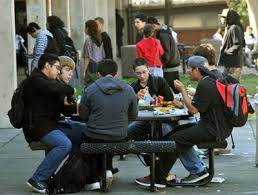 high school lunch table. Students At Antioch High School, In Antioch, Calif. Sit Outside To Eat Their Lunch On Thursday, Feb. 9, 2012. The 58 Year Old School Needs A Larger Table