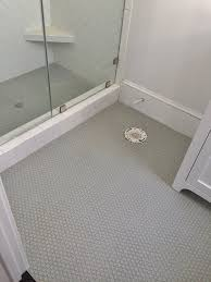 Gray penny rounds on Bathroom floor and shower floor, 3x6 white subway tile  set in