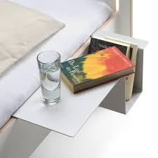 Bedside Metal Holder: A cool and sleek alternative to beside tables.