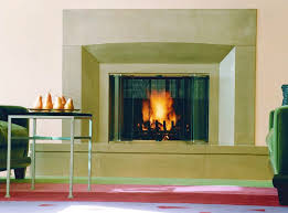 elegant fireplace surround made of concrete in an upscale sitting room