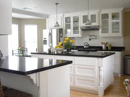 White Wooden Kitchen Island Come With Black Marble Countertop And