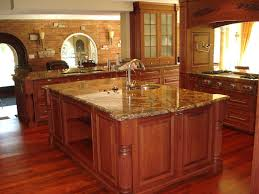 kitchen kitchen countertops pictures built in oven dark concrete tile flooring nickel single handle faucet