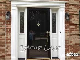 black storm door black door white frame and sidelights do nickel finish hardware though