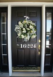 white single front doors. Lovely Wreath For Christmas Door Decors Attach At Single Black Front Doors Feat Bushed Brass Handle In Vintage Facade Entry Designs White R