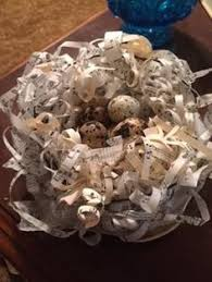 paper nest with quail eggs wire and paper strip nest book page nest