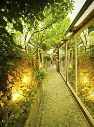 garden lighting ideas. well lights work great in a garden when plants grow around the lighting ideas y