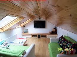 Media Game Room Converted Attic Space Above Garage. Add built in bunks on  the sides for guests. The skylight is nice too.