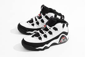 fila 95. as indicated above, the fila 95 retros come in either navy/white/red or black-on-black. this model sports a leather and nubuck exterior with perforation on fila s
