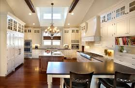 vaulted ceiling and skylight both provide an airy atmosphere to this sophisticated kitchen