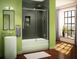 fresh green wall color and wooden floor for amazing bathroom ideas with modern glass sliding shower doors