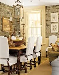 dining room with slipcovers in two parts bottom and top featured in country living