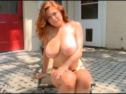 Huge melons on redhead