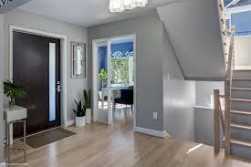 wood front door entryway with contemporary front door
