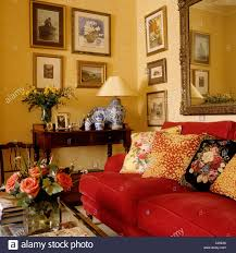 Traditional Furniture Styles Living Room Patterned Cushions On Red Sofa In Living Room With A Traditional