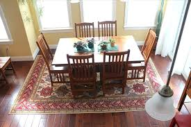 rug under dining table image of ideas best for jute