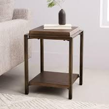 Two tier glass coffee tables are some of the furniture that you can truly admire not just for their beauty, but also for their contribution and impact in a home or office's you'll love this two tier coffee table as it doesn't just save valuable square footage; Square Wood Bronze Metal Side Table