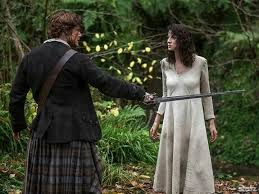 Image result for claire tending Jamie's shoulder
