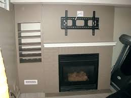 hang tv over fireplace hanging over fireplace best over fireplace ideas on above fireplace regarding hanging