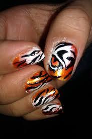 The 25+ best Tiger nail art ideas on Pinterest | DIY nails animal ...