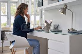 home office work. office work businesswoman entrepreneur working on laptop from home space stock photo