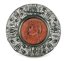a christ s head in c material with a silver filigree frame sicily 19th century