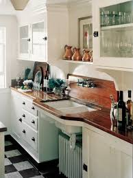 wood countertop and backsplash with sink