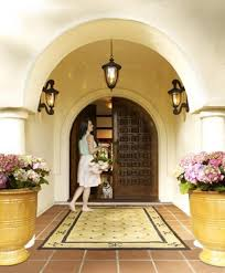 spanish style entryway featuring both wall and pendant lighting
