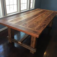 farm style dining table hand made from reclaimed barn wood on