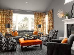 living rooms - orange gray drapes white foo dog lamps black Chinese altar  end table charcoal gray velvet sofa French brass tacks Kelly Wearstler  imperial ...