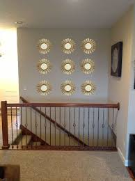 grouping mirrors on a wall how to