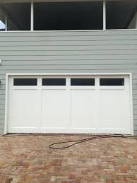 garage door opens after closing medium size of door door not closing fully garage sensor light garage door