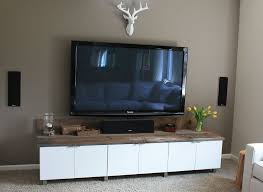Idea: TV cabinet / Deer credenza-ish piece Ive been looking for! DIY  Entertainment Center created from refrigerator wall cabinets from Ikea and  rustic wood.