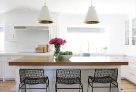 view full size gorgeous kitchen features a pair of white and gold pendants oversized cone shade