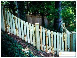 building a fence on uneven ground building a wood fence on uneven ground installing picket fence