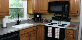 singular remodeled kitchen with new solid surface and faucet can you cover kitchen countertops with contact