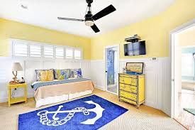 View in gallery Nautical kids' bedroom in blue, yellow and white